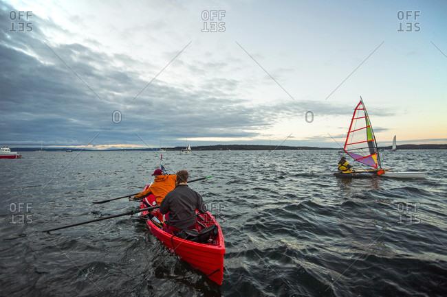 Port Townsend, Washington, USA - August 24, 2016: Two men rowing boat in the strait of juan de fuca