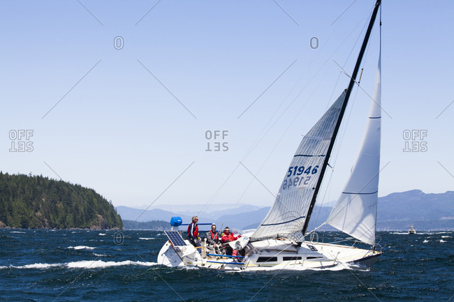 Johnstone Strait, British Columbia, Canada - July 21, 2017: Team members making way through johnstone strait off the coast of vancouver island