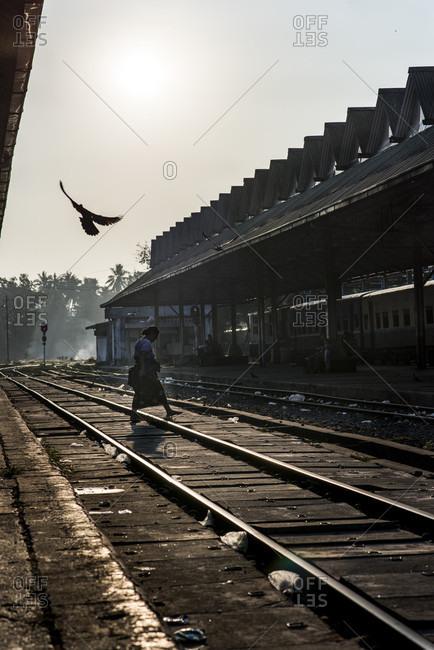 Yangon, Yangon, Myanmar - March 5, 2015: Silhouette of a person walking in a platform of the yangon central train station, myanmar.