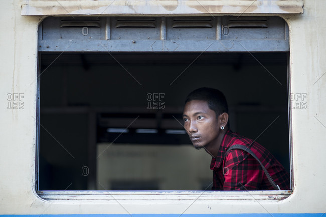 Yangon, Yangon, Myanmar - March 5, 2015: A young man waiting for the train to leave the station, central railway station, yangon, myanmar.