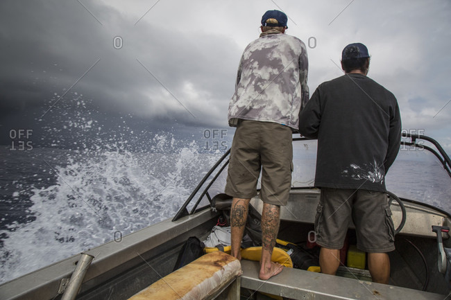 South Pacific, Samoa, Samoa - March 27, 2016: Angler jonathan jones and fatu, a samoan local, try to outrace an impending storm while fishing off the coast of samoa.