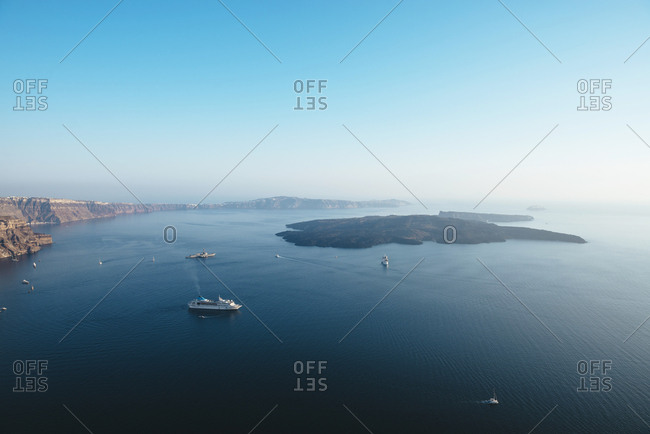 June 24, 2016: Greece- Santorini- Fira- ferries and small boats in the Santorini caldera