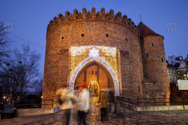 Poland- Warsaw- gate to the Old Town through Barbican fortified outpost of the city wall at night