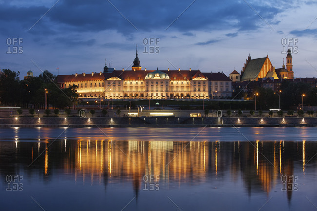 Poland- Warsaw- Royal Castle and Old Town skyline at dusk- reflection on Vistula River