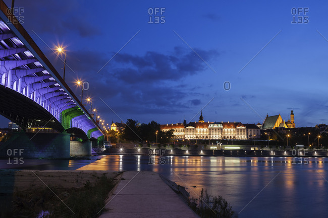 Poland- Warsaw- city by night- Old Town skyline with Royal Castle and bridge at the Vistula River