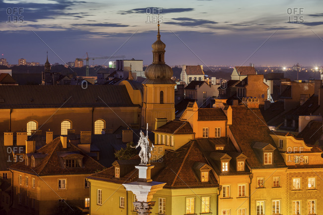 Poland- Warsaw- Old Town at dusk- historic houses rooftops- King Sigismund III Vasa statue
