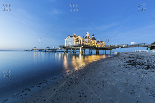 Germany- Ruegen- Sellin- view to lighted sea bridge at sunset