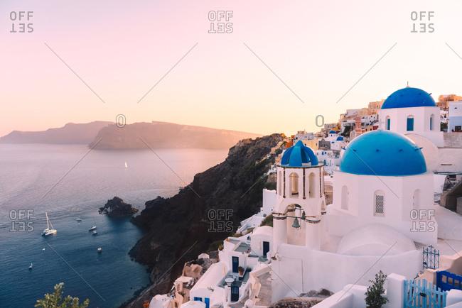 Greece- Santorini- Oia- view to caldera and Greek Orthodox Church at sunset
