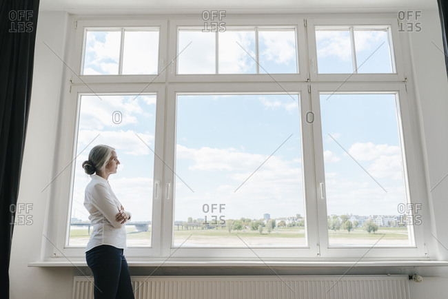 Businesswoman in office looking out of window