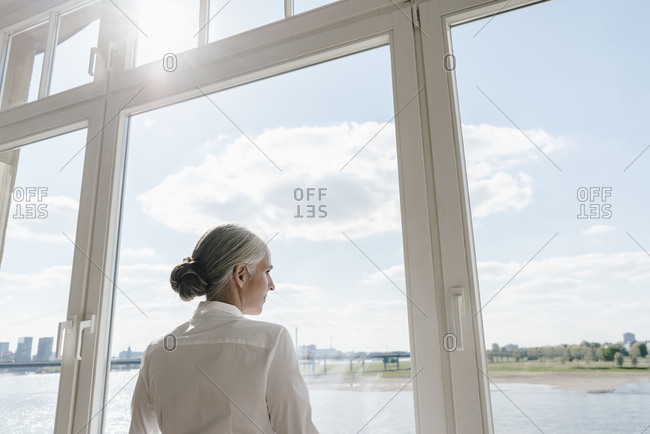Businesswoman looking out of window