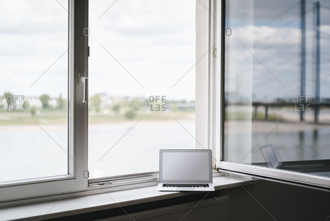 Laptop on windowsill