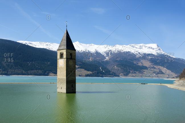 Italy- Alto Adige- Church spire of Alt-Graun in Lake Reschen