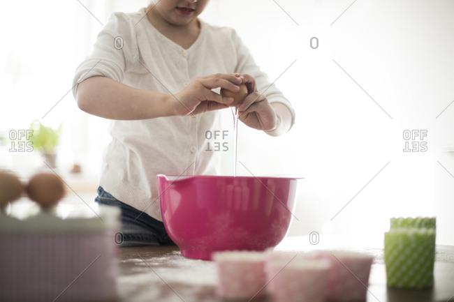 Girl separating eggs