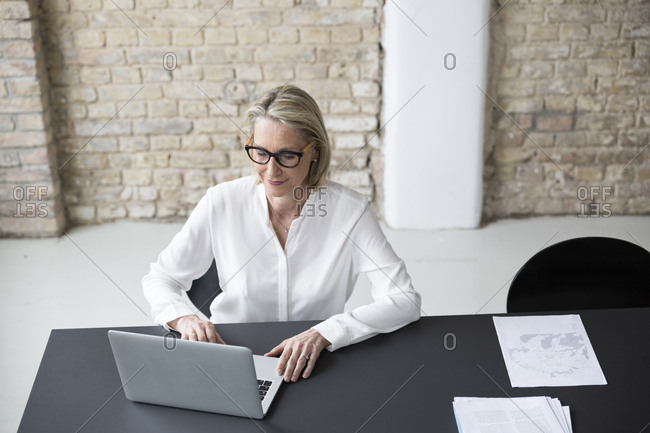 Mature businesswoman working in office