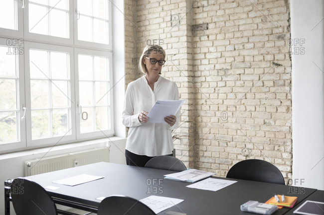 Mature businesswoman preparing for conference