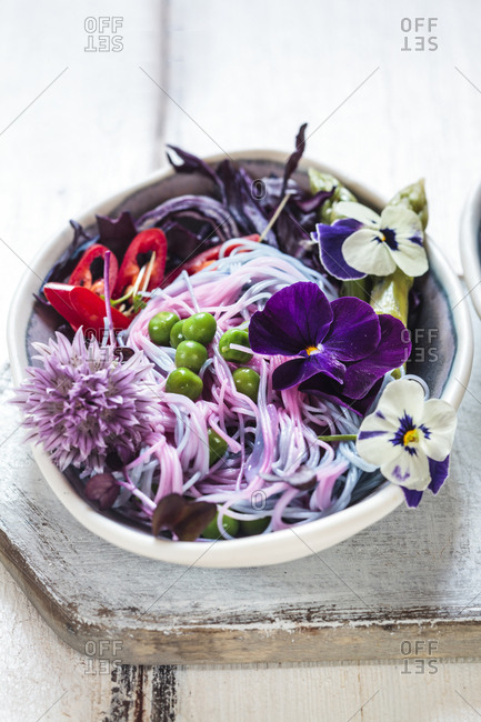 Vegan Unicorn Noodles- edible flowers- red cabbage- asparagus- peas- chili and sprouts