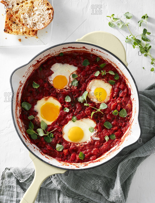 Skillet with shakshuka of tomato sauce and poached eggs