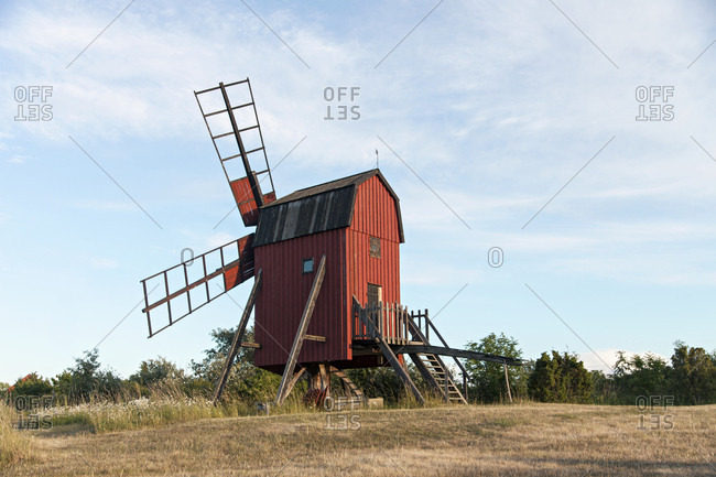 Red windmill in the countryside