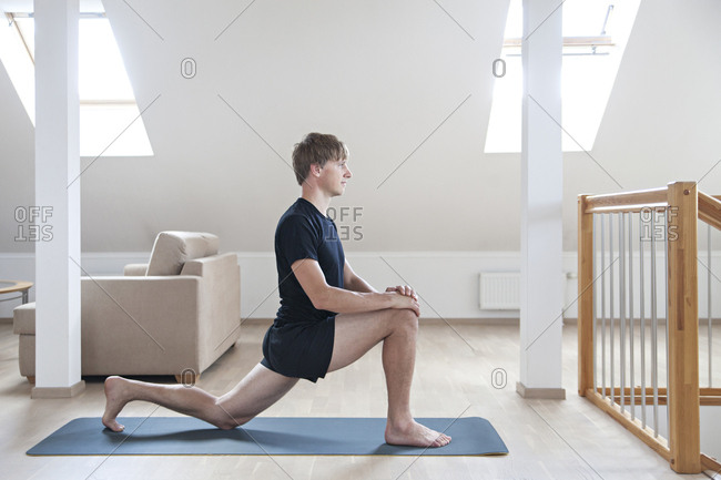 Man doing yoga in his living room