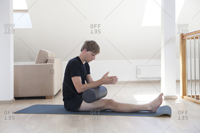 Man doing yoga with roller