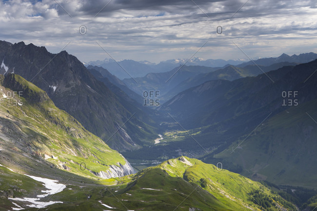 View over the Swiss Val Ferret to the village of Fouly, as seen from Col Ferret on the border of Italy and Switzerland. This pass is crossed on the Tour du Mont Blanc, a classic multi day hike that goes through France, Italy and Switzerland.