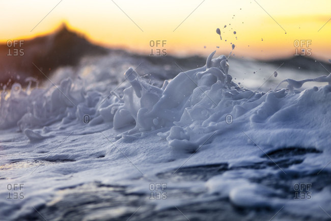 A foam wave captured during sunrise on the east side of Oahu.