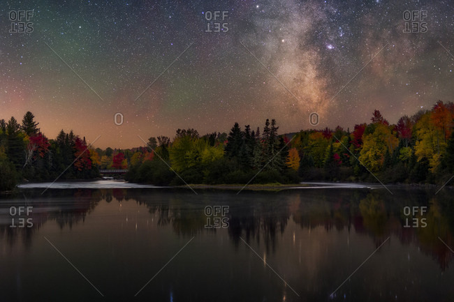 The Milky Way over the Androscoggin River in fall in New Hampshire.