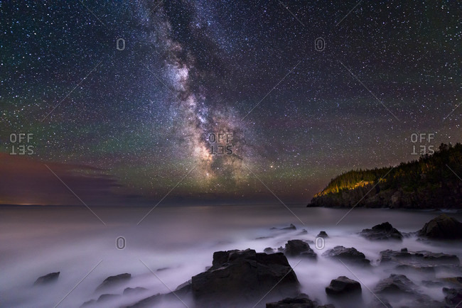 The Milky Way over the rocks and cliffs of the Bold Coast of Maine.