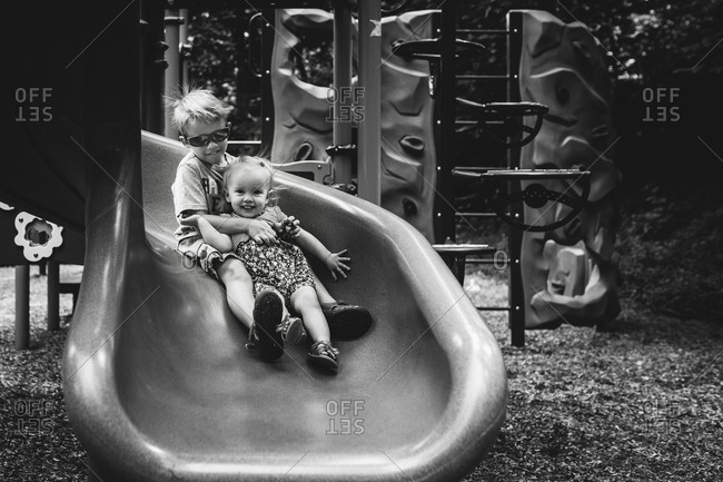 Kids sliding down slide