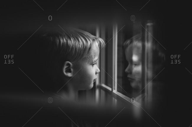 Boy looking outside
