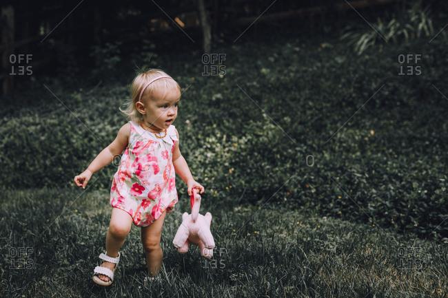 Baby girl walking outside