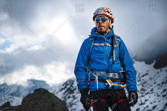 Alpinist up to a snowed mountain looking to the horizon in Estany, Colomina, Spain