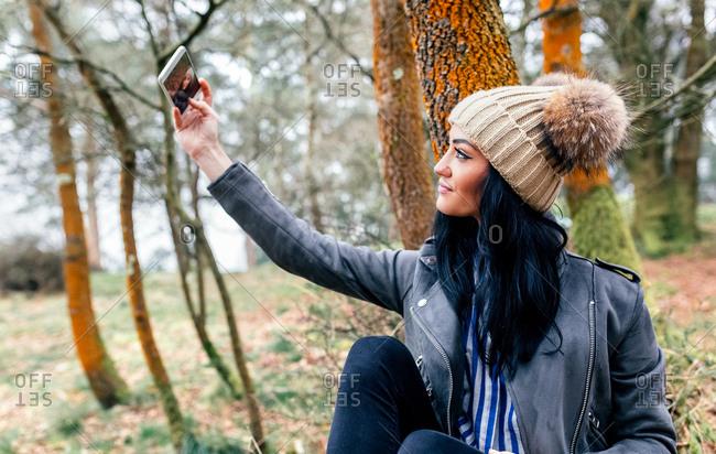Beautiful woman making a selfie outdoors