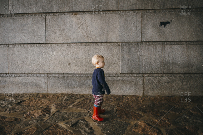 Toddler wearing red rubber boots