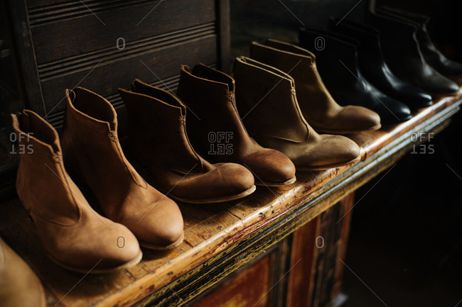 Pairs of leather shoes on shelf