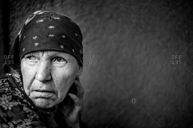 Vadeni, Moldova - July 24, 2017: A woman in headscarf looking away