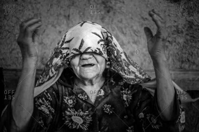 Vadeni, Moldova - July 24, 2017: Woman playfully covering eyes
