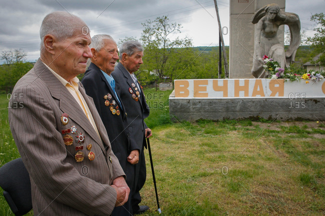 Vadeni, Moldova - May 8, 2017: Men by statue on Victory Day