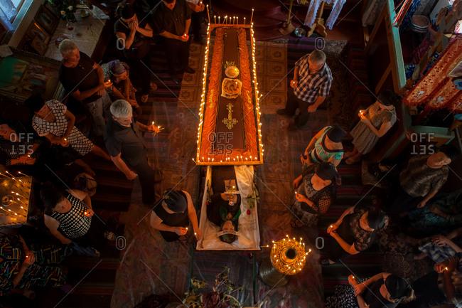 Vadeni, Moldova - August 15, 2015: People around casket at funeral