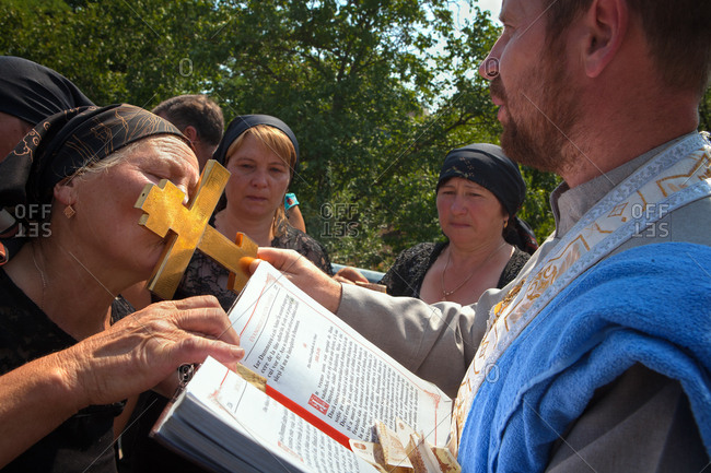 Vadeni, Moldova - August 15, 2015: People at a funeral