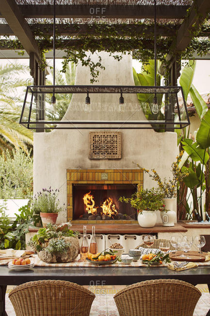 Calabasas, California - May 31, 2017: Outdoor dining area with fireplace