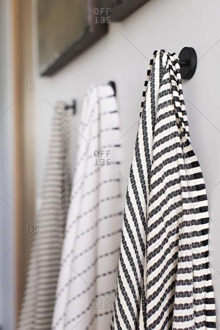 Bath towel hanging on hooks in a bathroom