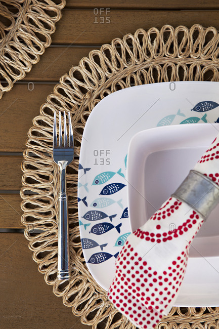 Overhead view of place setting with a fish plate on a wooden table
