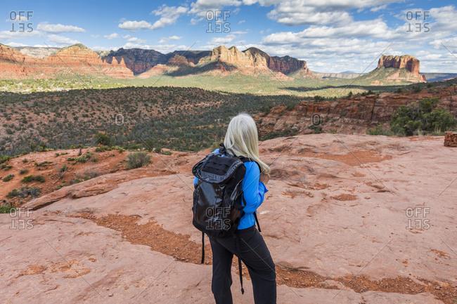 Caucasian woman hiking in desert landscape