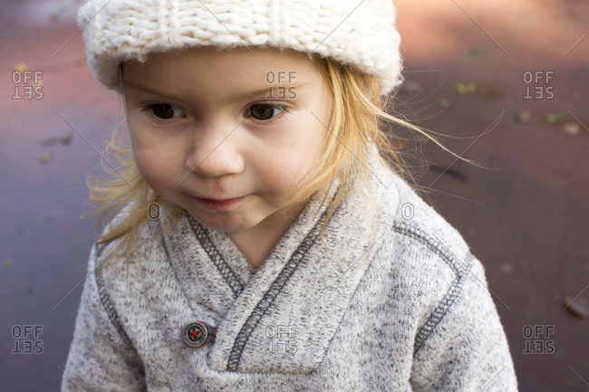 Close up of Caucasian girl wearing sweater and hat