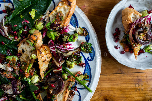 Fattoush salad with sauce vierge, brussels sprouts and pomegranate