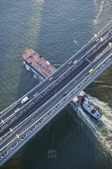 June 20, 2017: USA- New York City- barge sailing underneath Manhattan Bridge on East River- aerial view