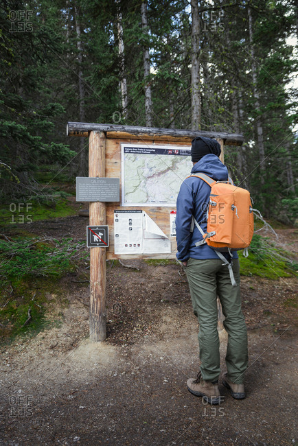 September 18, 2016: USA- Wyoming- Yellowstone National Park- man standing in front of an info panel