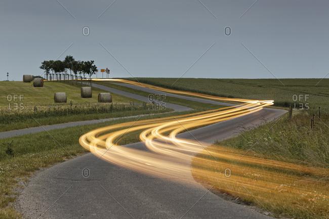 Germany- Mecklenburg-Western Pomerania- Rugen- light trails on road near Kap Arkona