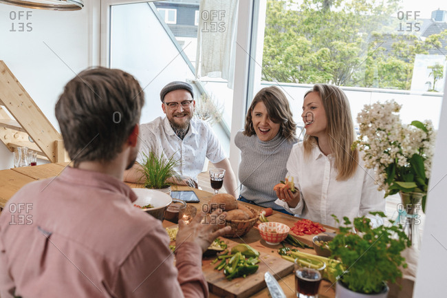Man telling stories while preparing food with his friends